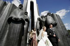 Young Belarus couple visiting Afghan war memorial on Island of Tears in Minsk; giant statues of represent mothers, sisters and children of those who died in the war.