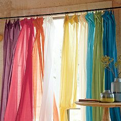 going to dye the cheap copy cat white ikea curtains blue and green and hang them in the kids' room. may add white too.