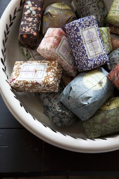 I would love to collect some pretty, colourfully packaged soaps and place in a decorative dish like this.