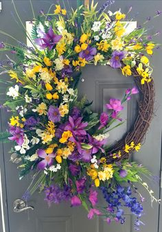 This gorgeous Summer wildflower Wreath is bright, colorful and sure to give your Summer Decor a pick me up. This gorgeous Summer wildflower Wreath is bright, colorful and sure to give your Summer Decor a pick me up. Spring Wreaths For Front Door Diy, Diy Spring Wreath, Easter Wreaths, Holiday Wreaths, Cemetery Decorations, Arte Floral, Flower Arrangements, Floral Wreath, Crafty