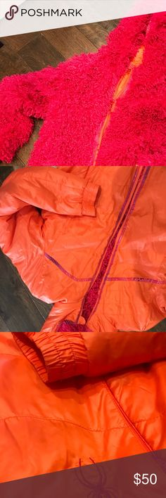 Reversible ski jacket So cute! EUC. This ski jacket reverses from a slick orange material to a loopy pick material. Super warm! This is a kids jacket size 16, but would fit a as a Small in womens. Great for all winter activities! Smoke free home. Spyder Jackets & Coats Puffers