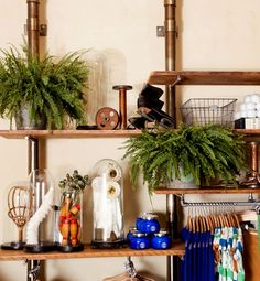 """From Retail to Your Room: Anthropologie: When it comes to displaying knickknacks and assorted finds, there is a fine line between curated and cluttered. How do the pros do it? """"It comes down to understanding what you're displaying,"""" says Sorgule. If you're displaying a collection of related items such as book, then place them together. But if a single object is so amazing, then it may be able to hold its own without other items to detract from it."""