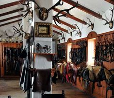Tack room in Spain - love the combo of riding gear and antlers