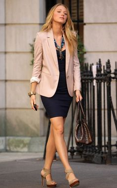 Classic blazer and dress paired with edgier accessories for a complete look.
