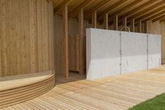 herzog & de meuron creates natural bathing pond for naturbad riehen
