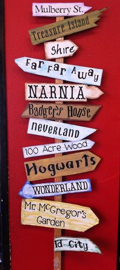 A story signpost. Use settings from children's books, musicals & plays, literature, places your family has traveled. Can use for a library, classroom, stage, garden, etc.