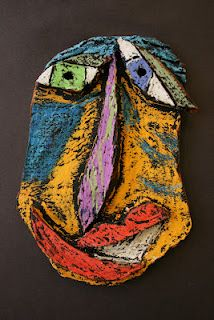 The students used clay and an oil pastel and black paint resist technique to create their masks. I really love how these turned out. The kids were a little scared to put the black paint on at first but they loved the end result and I do too!