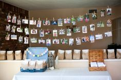 This is always a nice touch for birthday parties. Print out some of your favorite pictures from the year and use clothes pins and string to make a pretty photo display.