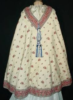 1860 red & white wool cape, blue tassel on false hood, quilted white silk lining
