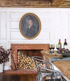 A mid-1800s portrait, which came with this Connecticut cottage, feels apropos against the dining area's original wood paneling. Steel bistro chairs from Industry West deliver a jolt of modernism.