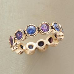 """LOVE SHINES ON RING--Aligning sapphires in cool hues, Jes MaHarry engraves the bezels with """"love"""" on one side, """"shine on"""" on the other. 14kt gold"""