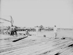 Florida Memory - People standing and fishing on docks at waterfront - Photographed in Cedar Key, Florida. August 15, 1949