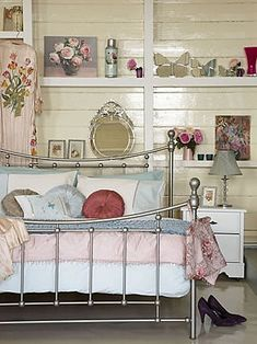 pastels shabby chic bedroom. love the bed frame and the shelves.