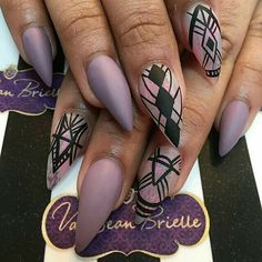 Lavendar Matte nails with black nail art. Stiletto nails