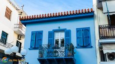 Blue building with shutters and an iron balcony in Nafplion, Greece - aswesawit.com