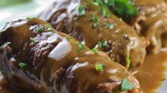 Thin steaks are wrapped around bacon and onions, pan-fried, and then simmered in beef broth, which is, in turn, made into a sour-cream gravy in this traditional German recipe. Guten Appetit!