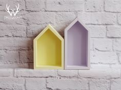 Great set of sunny yellow and lavender house-shaped shelves.