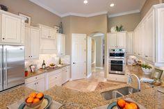 White kitchen with beige granite