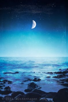 Stoney beach at night with half moon - composite image