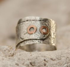Sterling silver ring with copper rivets.