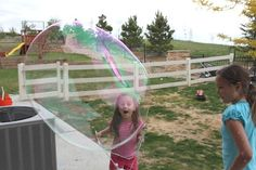 DIY Giant Bubble Wand by confessionsofahomeschooler: A seriously fun and cheap activity! #Giant_Bubble_Wand #Kids #confessionsofahomeschooler