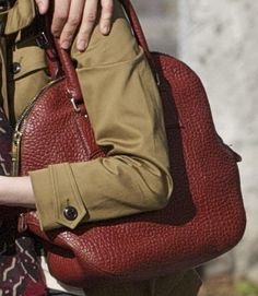 bbb6e80eab35 Emma Stone Carries a Deep Red Burberry Orchard Satchel Bag