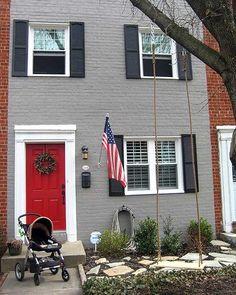 brick house with red door