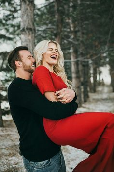 Carson McAllister lifts fiancee Witney Carson in engagement photo