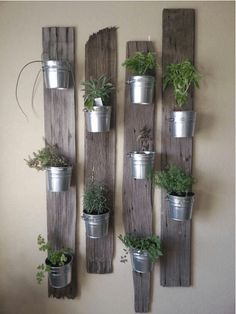 Vertical Gardens indoor herb garden idea: Tin Buckets on Re-Purposed Wood - In this post, we'll share 9 beautiful ways to bring your herb garden indoors, so that you can enjoy fresh herbs all year long.