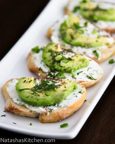 Canapes with Garlic Herb Cream Cheese and Avocado--The herbed cream cheese infused with a little garlic makes for an amazing spread for crostini. Top with avocado and you have a very impressive little tea sandwich. My cousin Lena shared a photo of these (her favoritecanapés) on Instagram and I couldn't resist trying...
