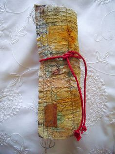 'Mark making' rolled books by scrappy annie (flickr) MORE BOOKS http://www.flickr.com/photos/14903992@N08/sets/72157625377700089/with/5808930670/  #handmade_books #handmade #textile_art #crafts #bindings #fabrics #crafts #book_arts
