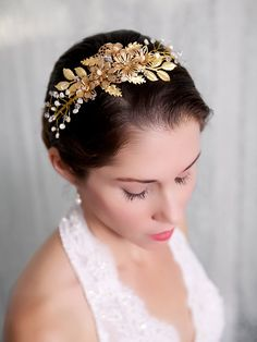 More jewelry-matching loveliness.  Gold Flower Bridal Headband Pearl Crystal Hair by GildedShadows, $148.00