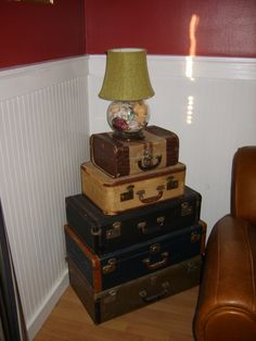 I use these old suitcases as an end table