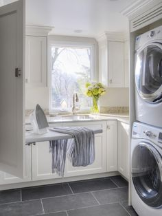 Compact laundry room, built in ironing board and lots of sunshine.
