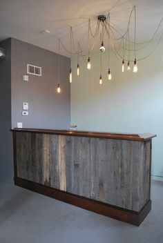 We just finished our bar/check out area. Made from 100+ year barn wood, reclaimed slate, and modern trim.