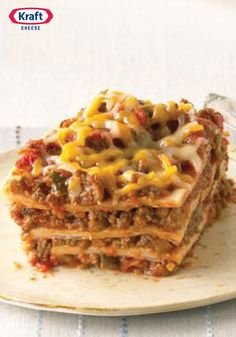 Our Favorite Mexican-Style Lasagna — Create a little fusion with ooey-gooey cheese, beans and taco beef layered up and baked like lasagna in this tasty recipe.