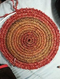"Crochet around clothesline rope to make a rug or hot pads. Click on link, click on ""Free Pattern Index"", scroll down to Clothesline Crochet and click on ""Clothesline Crochet in the Round Tutorial"""