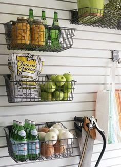 an idea to get some of these wire baskets/acrylic containers from Ikea/Howards for the onions, garlic, ginger, and fruits and hang them from the bar across the prep area in front of the glass panel facing the entrance