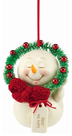Nothing says jolly like a festive holiday wreath, complete with bow. This snowman will bring the jolly to your home! Snow pinions, a line of sometimes-sweet and sometimes-sassy snowmen, is designed by Kristi Jensen Pierro exclusively for department 56.