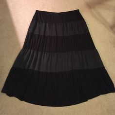 Black tiered maxi skirt Flowy black tiered maxi skirt.  Worn once with grey and white and it looked great.  Summer's coming!! Lane Bryant Skirts Maxi