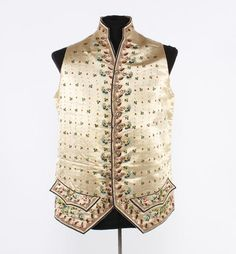 Waistcoat, c. 1770-1800. Cream silk satin, embroidered with stylized flowers, including fuchsias and carnations in polychrome floss silk.
