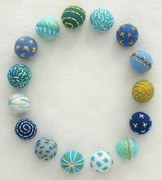 Embroidered felt beads