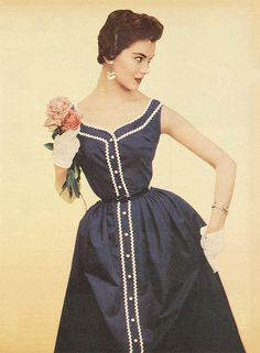 Long lines of white rickrack add additional visual interest to this lovely 1950s Candy Hardy dress.