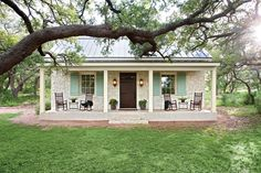 Texas Farmhouse - Charming Home Exteriors - Southernliving. This casual Hill Country cottage pours on the Southern charm with its familiar farmhouse form, picture-perfect proportions, and inviting front porch nestled beneath a curtain of large oak trees. The stone facade and metal roofing nod back to Fredericksburg's original German-style architecture. We'd love to kick up our feet and wind down our week in this soulful country home.