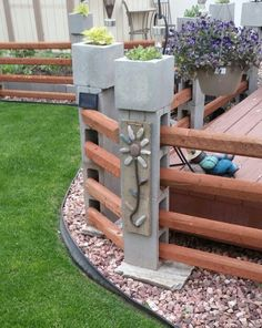 Cinder block wood fence with Rock art ~-> rock art transforms this ...