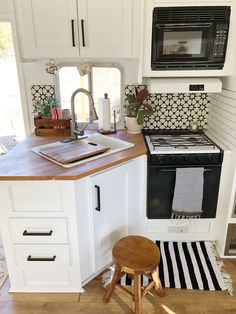 The black and white tiles are from the Cement Tile Shop. The butcher block countertop is from IKEA.