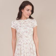 Handmade floral dress with lace collar by Plum and Pigeon. This pretty dress is handmade using a vintage style floral fabric, with a fitted bodice, short sleeves and peter pan collar with lace trim.