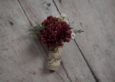 Wine cork boutonnieres are the perfect groom's accent for a rustic vineyard wedding. Burgundy red poms are accented with berries and dusty miller and sit in a wine cork. Each cork in your package will Burgundy Wedding Flowers, Diy Wedding Flowers, Floral Wedding, Wedding Bouquets, Wedding Ideas, Wedding Images, Wedding Trends, Wedding Favors, Bodas