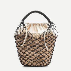 Raffia bucket bag with netting overlay