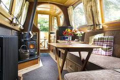 Saloon with log stove. Lower front door to walk out Barge Interior, Best Interior, Interior Ideas, Living On A Boat, Tiny Living, Canal Boat Interior, Aka House, Canal Barge, Narrowboat Interiors